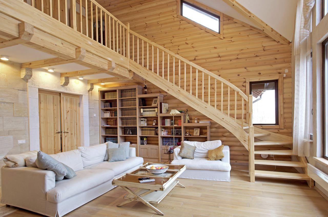 гостиная с лестницей в интерьере